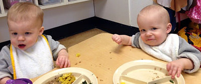 Twin boys eating